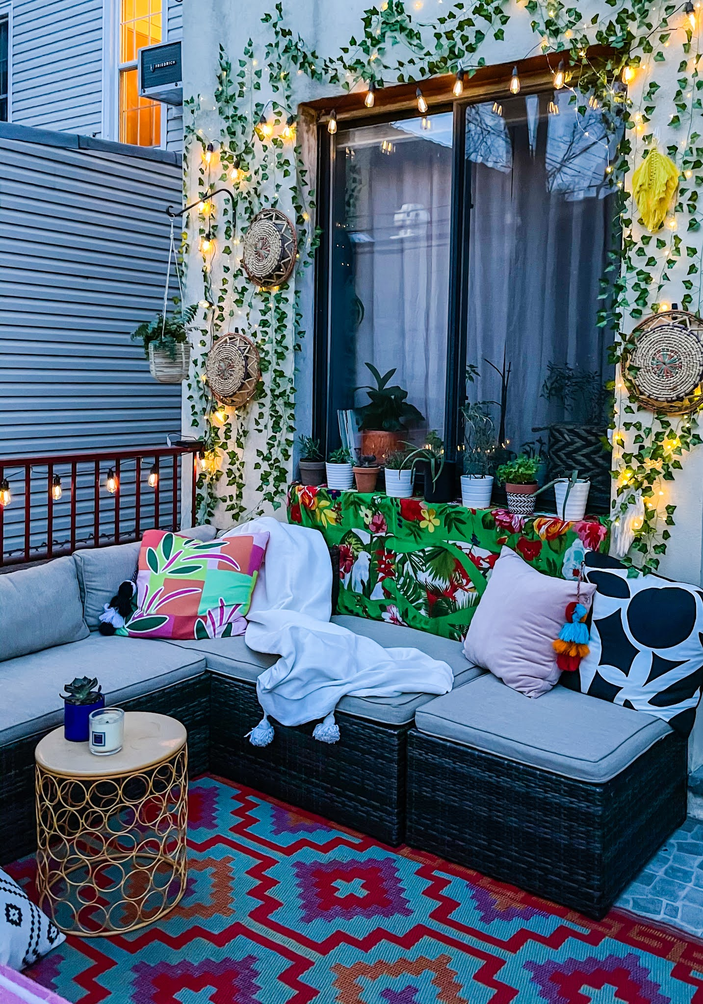 Renter-Friendly Patio Decor,  patio decor, faux ivy wall, command outdoor light clips, patio decor ideas, faux ivy wall diy, small space patio decor, small patio design ideas, renter friendly patio ideas, fairy lights patio ideas, small space outdoor decor