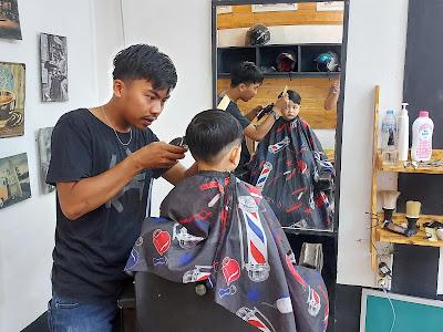 Muzkha Nofrenda Pangkas Rambut