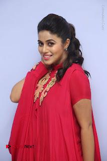 Actress Poorna Latest Stills in Red Dress at Rakshasi First Look Launch  0044.JPG