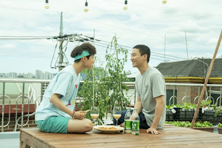 Made on the Rooftop - two men sitting having a picnic on a flat roof