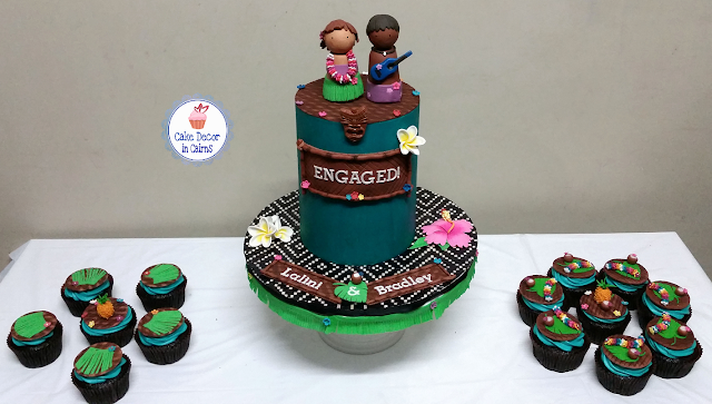 Teal Chocolate Ganache Cake Fondant Frangipannis Hibiscus Grass skirt Pineapple Coconuts Tiki Mask Mats