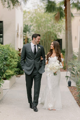 bride and groom smiling and walking