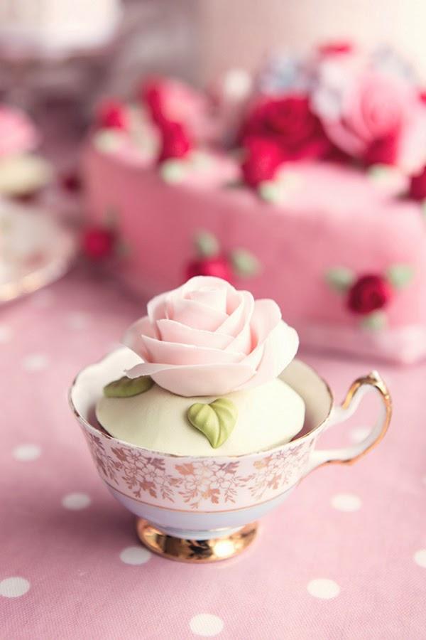 Sugar craft rose on a cupcake in a gold gilt tea cup
