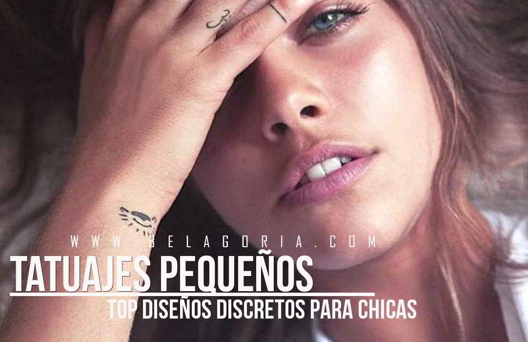Preciosa foto de una modelo con mirada penetrante, lleva tatuaje pequeño dedos y muñeca
