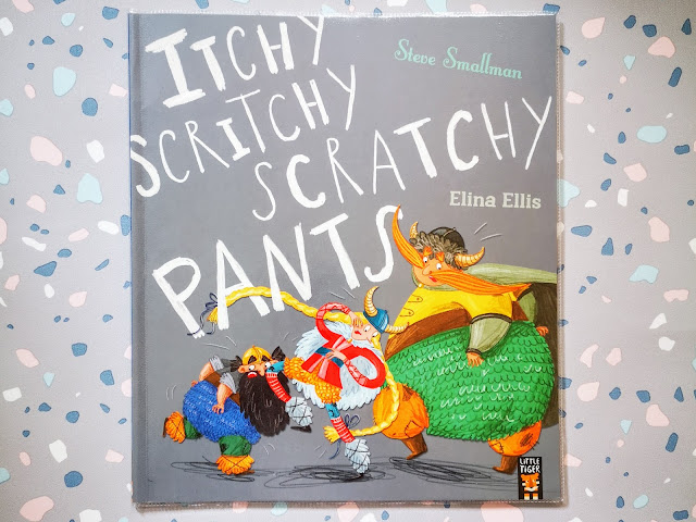 Image of the front cover of itchy, scritchy, scratchy pants by Steve Smallman and Elina Ellis. Features the book title and author's names alongside an image of 3 viking's all in knitted pants scratching their bottoms. The book is laid on a pastel pebble effect background.