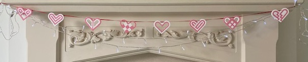Hama bead heart bunting on the mantelpiece