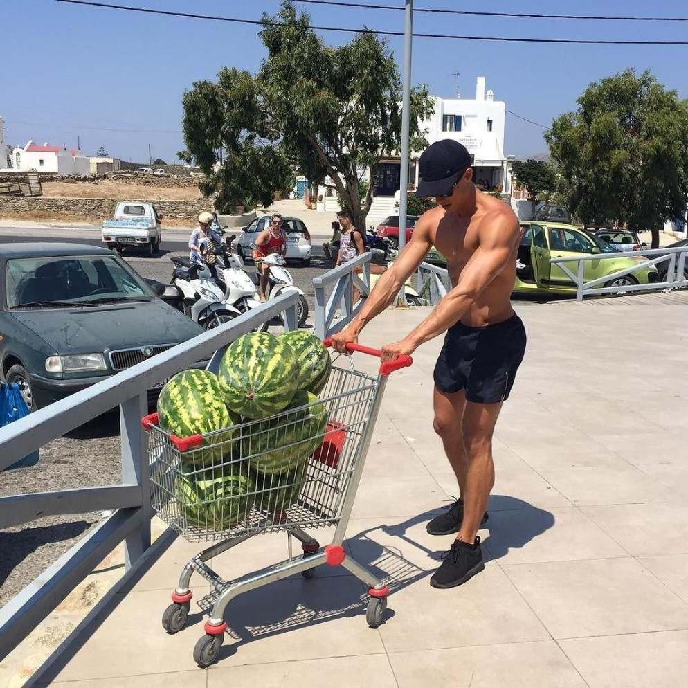 sexy-hunk-carrying-watermelons-shopping-cart