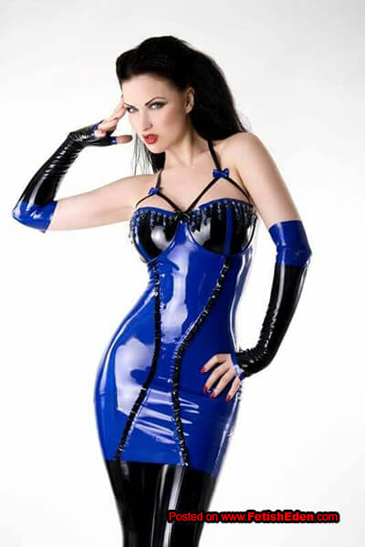 Sister Sinister black-haired lady in blue latex mini-dress with long black latex gauntlets