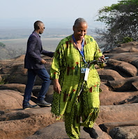 Dr. Tucker climbing along a hillside during her visit to Angola