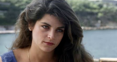 Claire, played by Kirstie Alley, looking concerned and fabulous with hypnotic eyes.