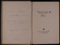 "A copy of ""The Picture of Dorian Gray,"" open to the titled page. It is inscribed and signed."