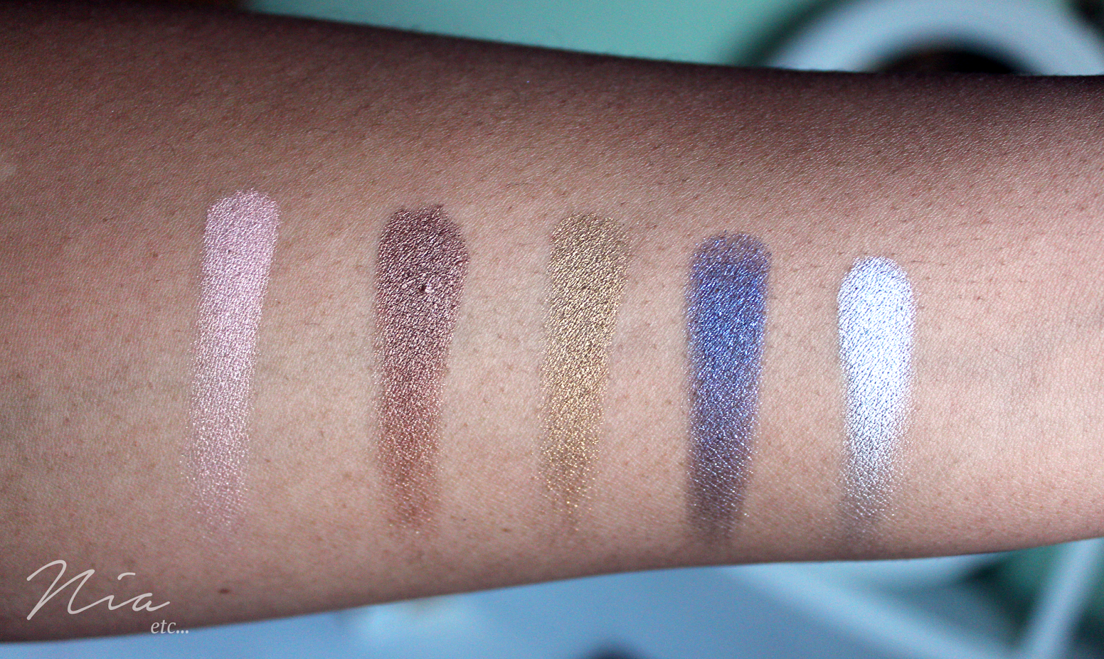 Too Faced Pretty Rebel Eyeshadow Swatches in Ringleader, Gangsta, Instigator, Badass and Jailbird