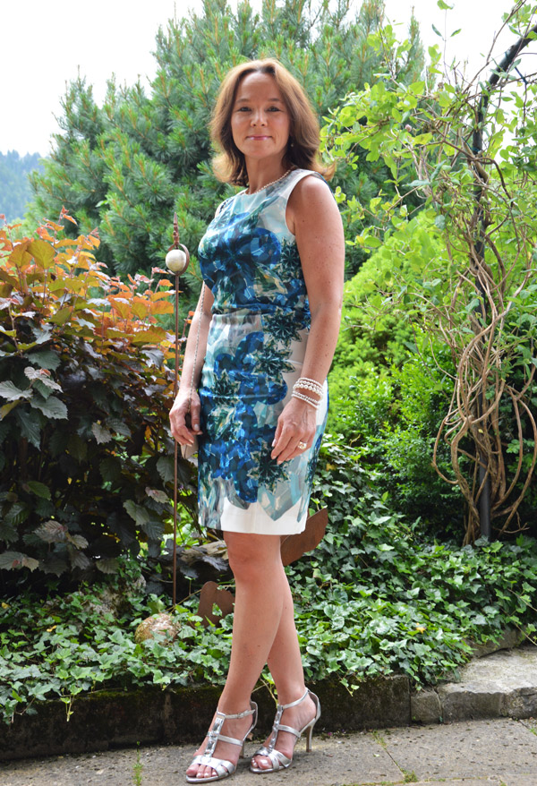 Awesome Mature Woman Wearing Short Skirt Leaning On A Stable Wall Stock Photo