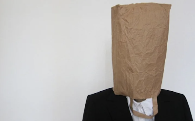 Mindlessness man in a paper bag picture