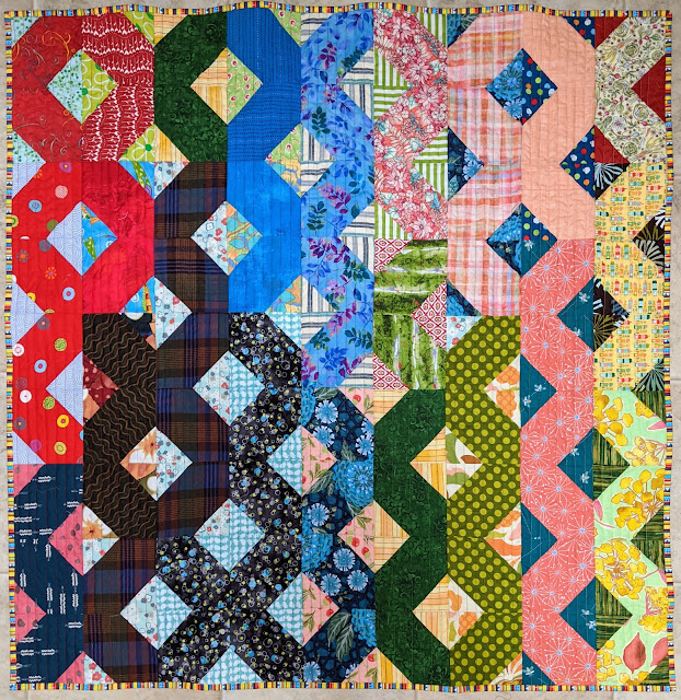 Moving the coral and green streamers created the final layout of the Hatchet quilt and blurred the value changes across the quilt