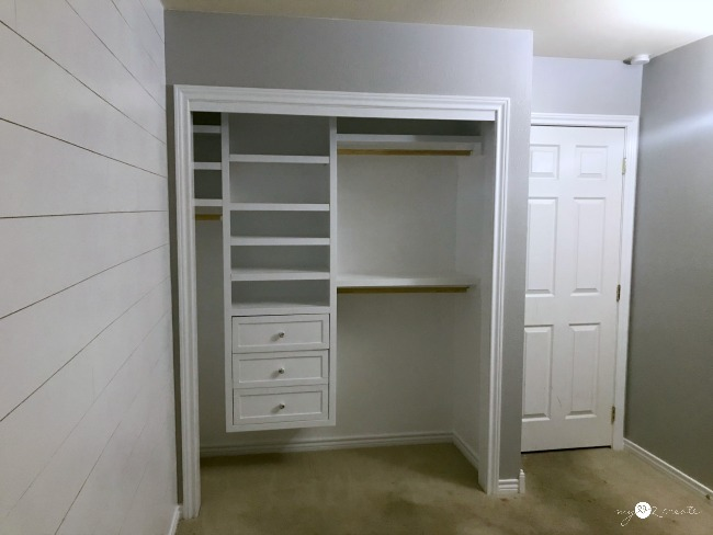 painted room with built in closet and plank wall