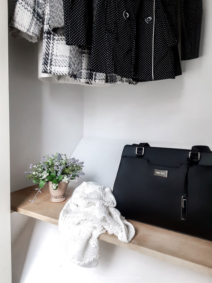 Shelf in coat closet.