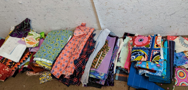 These stacks of fabric wait to be put on the design wall or be returned to their boxes
