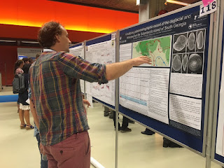 Rowan in discussion at this poster about the Holocene paleoceanography in South Georgia (Southern Ocean).