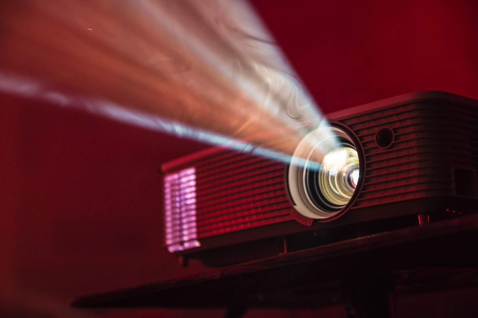 a portable video projector with light coming out of lense for blog post about movies darkest hour and 12 strong