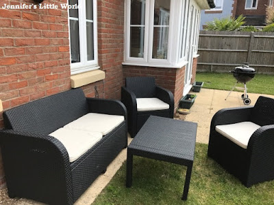 Summer garden furniture on patio