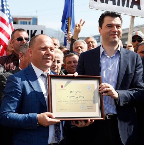 Xhelal Mziu and Lulzim Basha holding Donald Trump's Honorary Citizen Certificate
