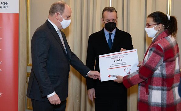 President of the Monaco Red Cross Prince Albert presented a check to Princess Stephanie