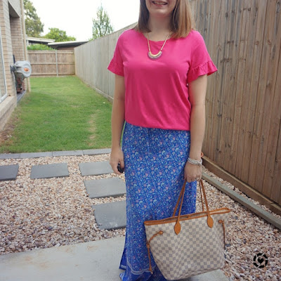 awayfromblue Instagram | bright colourfum summer SAHM outfit with floral maxi skirt and fuchsia pink statement sleeve tee