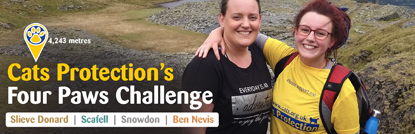 two female mountain climbers with Four Paws Challenge logo