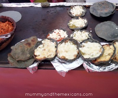 Breakfasts On The Go In Mexico - Blue Corn Sopes On A Market Stall