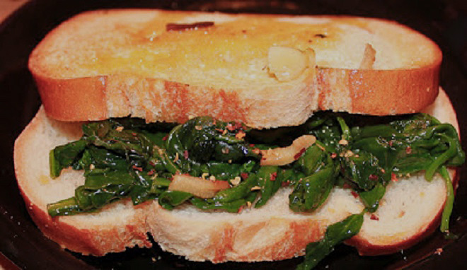 this is a sauteed spinach sandwich with red pepper flakes