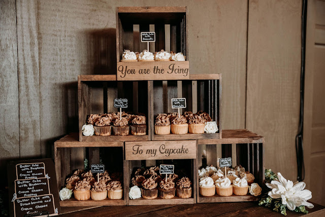 wooden rustic cupcakes at wedding reception