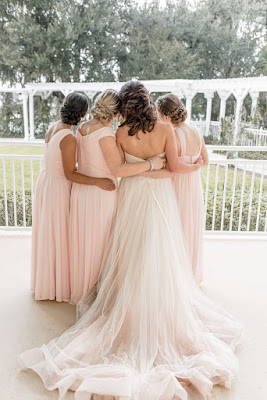 back of bride and bridesmaids