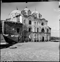 Fethiye Camii (Monastery of the Theotokos Pammakaristou), exterior view from Southwest, May 1937.  Artamonoff took this picture just before the restoration of the building which took place in 1938-1940.  When he photographed the building again in 1938, the wooden structure that rests on the southern wall of the temple and washing hanging out to dry had of course disappeared [Credit: © Nicholas V. Artamonoff Collection, Image Collections and Fieldwork Archives, Dumbarton Oaks]
