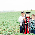 Inspiring photo shows college grad standing in the fruit fields where her immigrant parents work