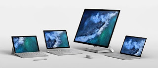 From left: Surface Pro, Surface Book 2, Surface Studio, and Surface Laptop. The Surface Pen is in the foreground on the left, and the Surface Dial in the centre of the foreground.