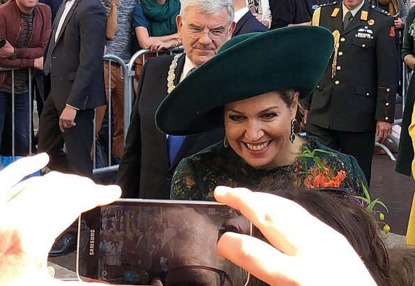 Dutch Queen Máxima attended Leidsche Rijn's 20th anniversary celebrations. Queen wore a green lace dress and pumps by Natan. diamond earrings