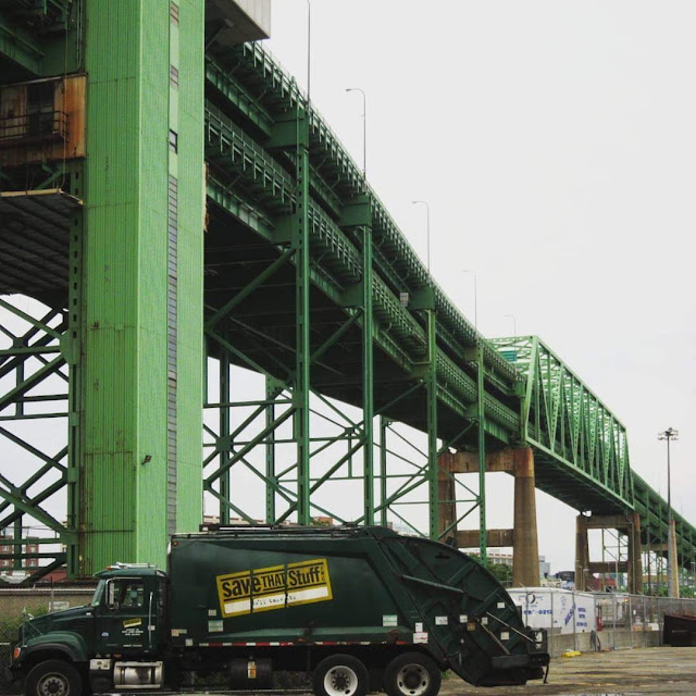 Garbage truck under the Tobin Bridge in Boston