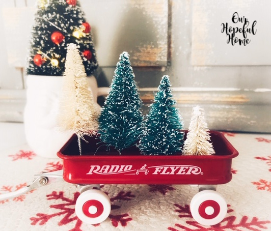 red radio flyer wagon bottle brush trees decor