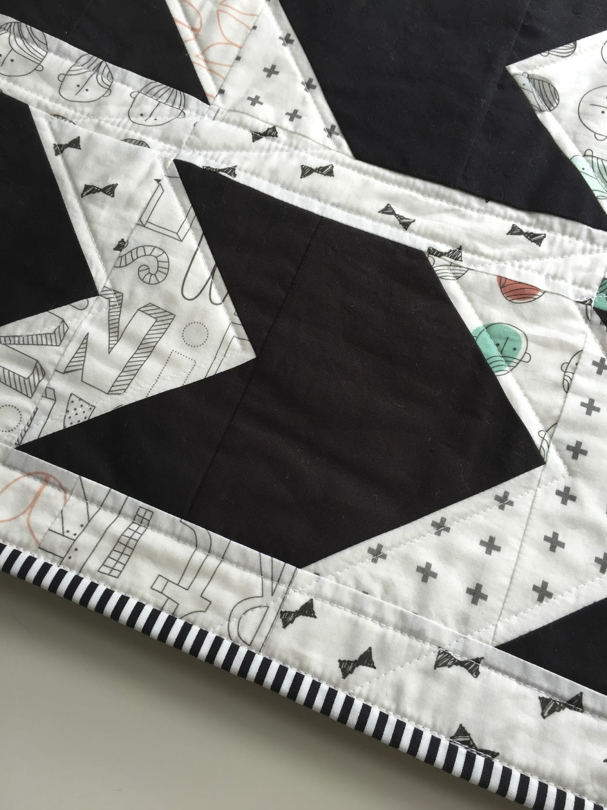 Black and white pow wow quilt in cotton lawn