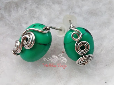 Turquoise wire wrapped earrings with small swirls in front