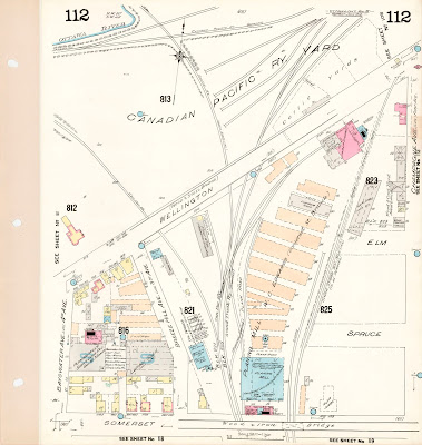 Plate 112 from the 1912 Fire Insurance maps. This shows the section between Champagne Ave and Bayswater Ave north of sOmerset Street, including the entire Wellington Street viaduct. The Canada Atlantic Railway line at the east end of the railyards is labelled 'Grand Trunk Ry (Main Line)' and '(To be removed)'. It is depicted as ending on the south side of Wellington Street just west of Champagne Ave. The other rails are as described in an earlier caption.
