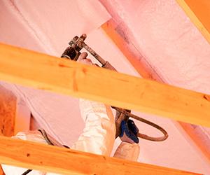 Installer Applying Spray Foam Insulation to Attic; Foam Insealators of Maryland and Virginia