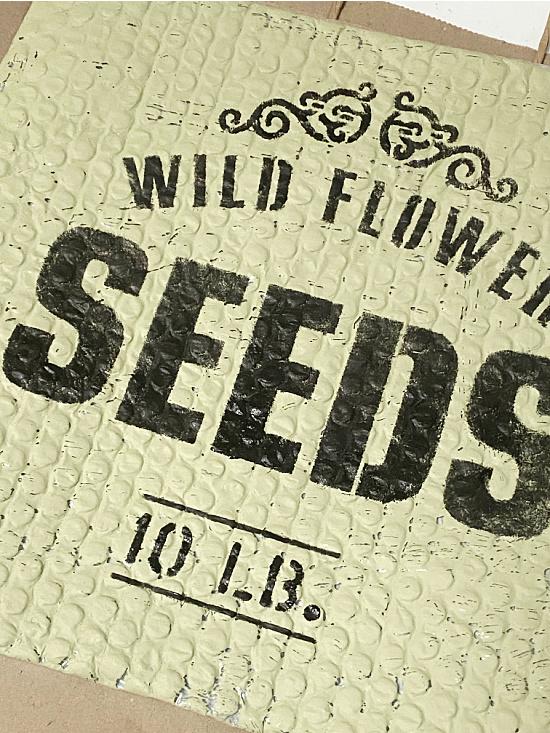 old sign stencil wild flower seeds