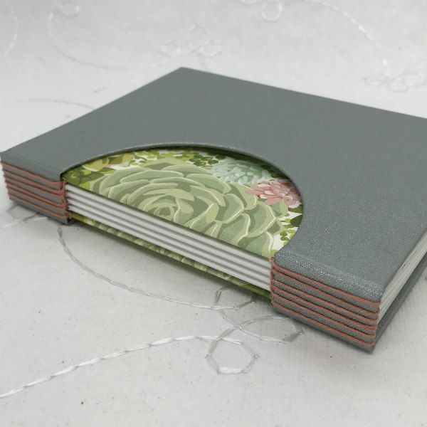 decorative handmade sketchbook with half circle cut out cover and succulent patterned paper