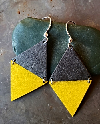 Genuine leather and sterling silver handmade earrings with one grey triangle and one yellow triangle
