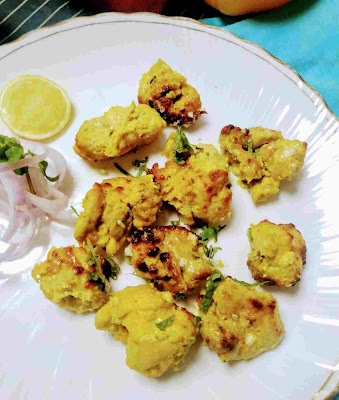 Serving chicken reshmi kabab with onion sliced and lemon wedges