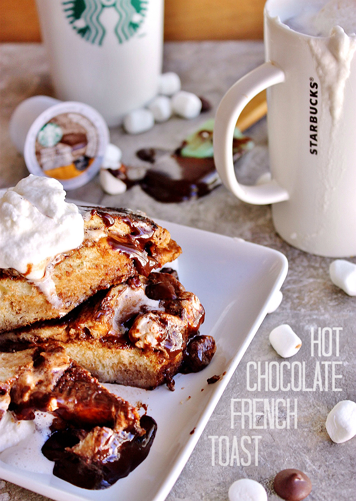 Thick Challah bread slices slathered in homemade chocolate Ganache, sandwiched with miniature marshmallows, and soaked in a rich Starbucks Salted Caramel Hot Cocoa egg wash. Pure heaven. Enjoy this delicious Hot Chocolate French Toast alongside a mug of Starbucks #HotCocoa #Kcup varieties. #IC (ad)
