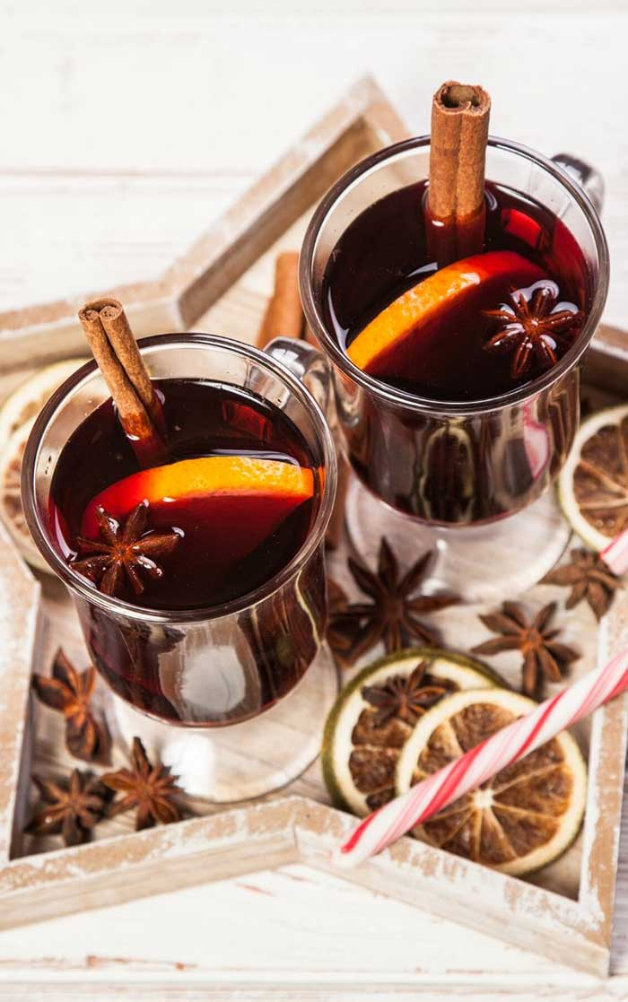 How to make mulled wine in a Crockpot slow cooker. The easy recipe can be made with brandy or without. Make it sugar free with maple syrup or honey so it's still sweet. This classic fall drink is also good for Thanksgiving or Christmas for the holiday season. Use mulling spices or a mix of dried spices for the best simple mulled wine recipe. #mulledwine #drink #wine #recipe