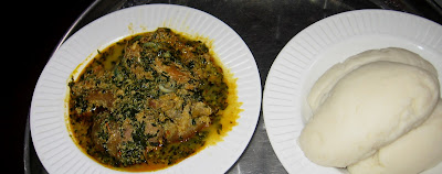 Egusi (melon) soup with a side of pounded yam